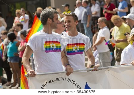 MONTREAL, QC - AUG 19, 2012: Gay and lesbians walk in the Gay Pride Parade in Montreal, QC on Aug 19, 2012.