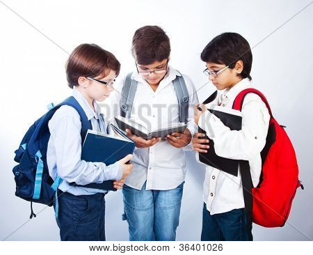 Three smart boys read books, classmates make homework, schoolboys learning lesson, clever three male pupil in glasses isolated on white background, back to school, studying and education concept