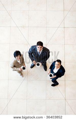 overhead view of colleagues having coffee break at work