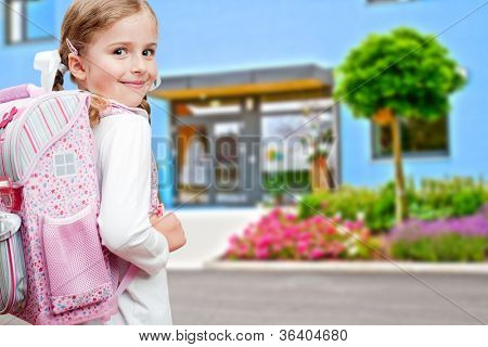 Back to school - lovely schoolgirl on the way to the school