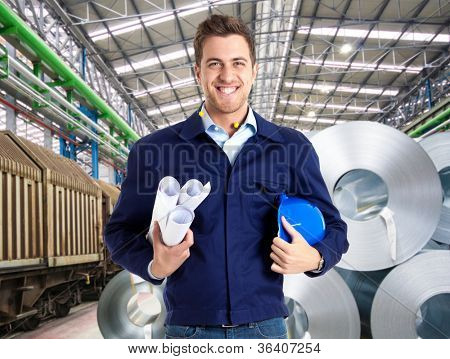 Portrait of an handsome engineer at work in a factory