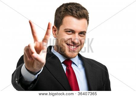 Businessman showing a victory sign