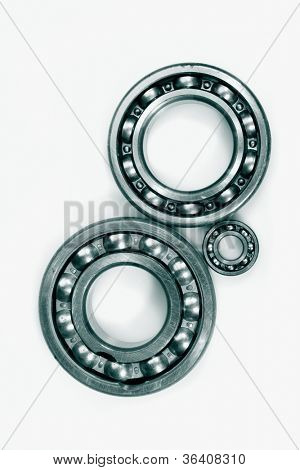 ball-bearings and gear wheels, duplex green toning idea, set against a light background