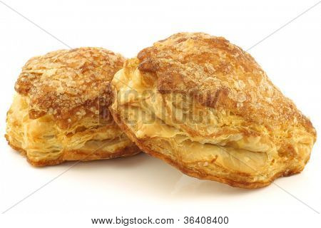delicious puff pastry cherry turnovers on a white background