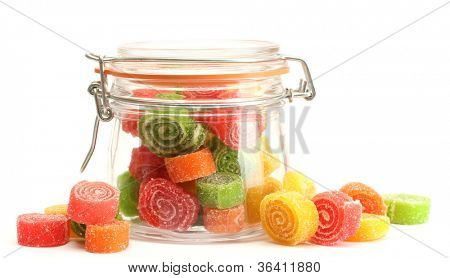 colorful jelly candies in glass jar isolated on white