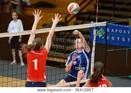 KAPOSVAR, HUNGARY - APRIL 22: Zsanett Pinter (in blue) in action at the Hungarian I. League volleyball game Kaposvar (blue) vs Budai XI. SE (red), April 22, 2012  in Kaposvar, Hungary.