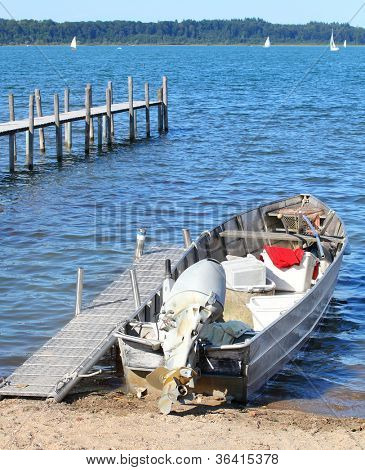 The fishing boat on the lake ( The Chiemsee Lake, Bavaria, Germany).