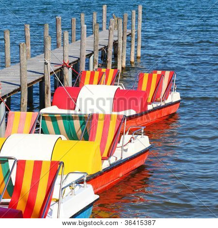 Colorful boats on the lake ( The Chiemsee Lake, Bavaria, Germany). End of summer concept.