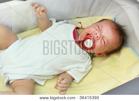 Crying baby in the stroller. Child abuse concept.