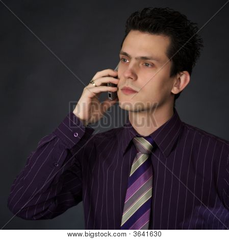 Young Man Using A Cellhone