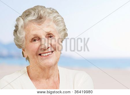 healthy senior woman smiling at the beach
