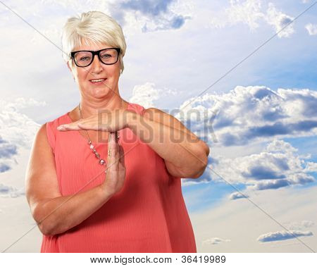 Portrait Of A Senior Woman Showing Time Out Signal, Outdoor