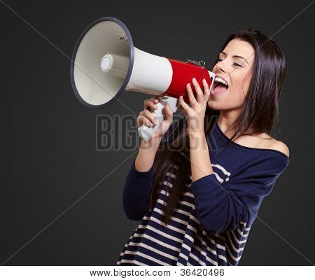 Portrait Of A Female With Megaphone On Black Background