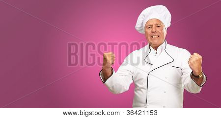 Portrait Of Angry Chef On Red Background