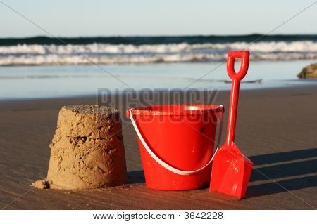 Sand Castle And Red Bucket