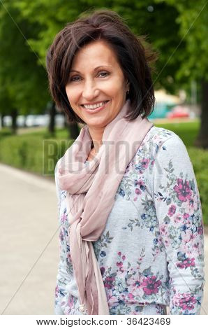 Portrait of smiling brunette woman in park