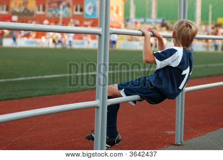 Stand By Boy In Sport Uniform In Stadium
