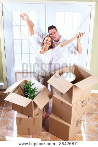 Happy couple moving in a new house. Real estate.