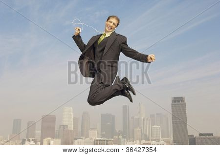 Caucasian businessman listening to music in midair