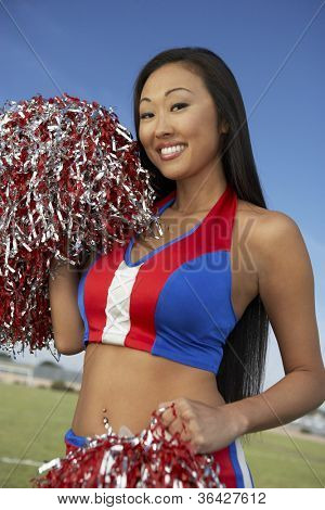 Japanese cheerleader holding pompoms