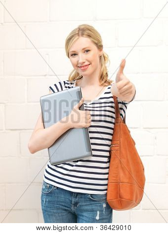 picture of smiling teenage girl with laptop showing thumbs up