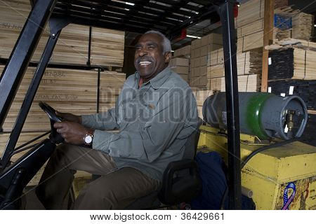 Man sitting in a forklift