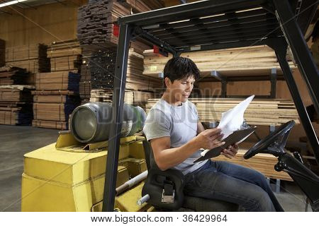 Young man driving forklift