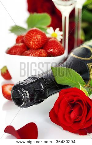 Romantic still life with champagne, strawberry and beautiful red roses over white