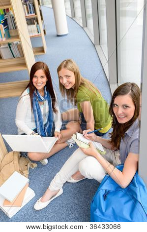 Group of high school students sitting floor self educating