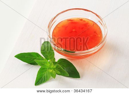 Bowl of tangy appetizing red tomato dressing