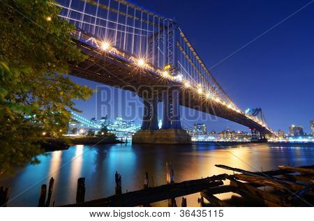 The Manhattan Bridge Spans the East River from the borough of Brooklyn to the borough of Manhattan in the city of New York, New York, USA. Brooklyn Bridge is visible in the distance.