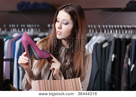 Pretty woman wonders at excellent fuchsia shoes