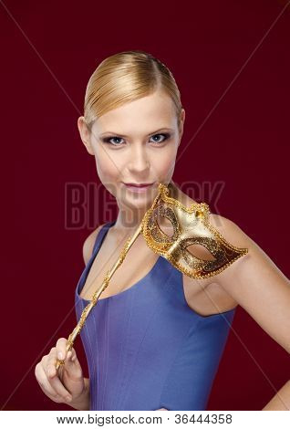 Attractive woman with masquerade mask, isolated on purple