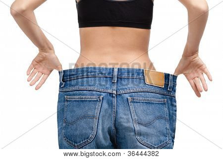 Body of a slim girl wearing enormous jeans, isolated on white