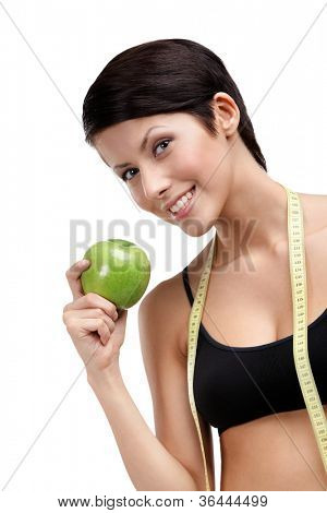 Indulging fitness woman with flexible ruler and green ripe apple, isolated on white
