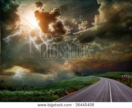 The road through the meadow and the stormy skies