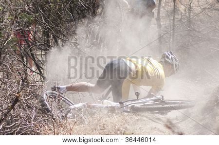 CLUJ-NAPOCA, ROMANIA - MARCH 24: Unidentified competitor falling during the Clujul Pedaleaza mountain bike competition, 1st stage