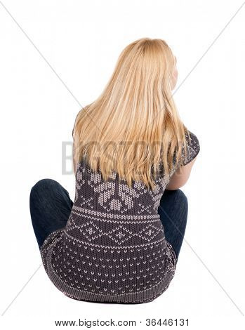Back view of beautiful woman relaxes and looks into the distance. Blonde young girl sitting. Rear view people collection.  backside view of person.  Isolated over white background.