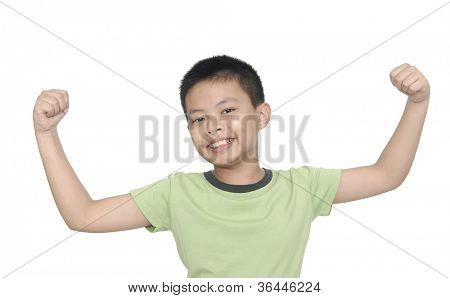 little boy flexing biceps isolated against white background