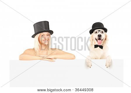 Female and dog with top hat posing behind white panel isolated on white backgroud