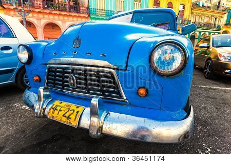 HAVANA-AUGUST 14:Shabby old Dodge in a colorful neighborhood August 14,2012 in Havana.These old cars,the only ones that could be bought until last year,are an iconic sight on the streets of the city