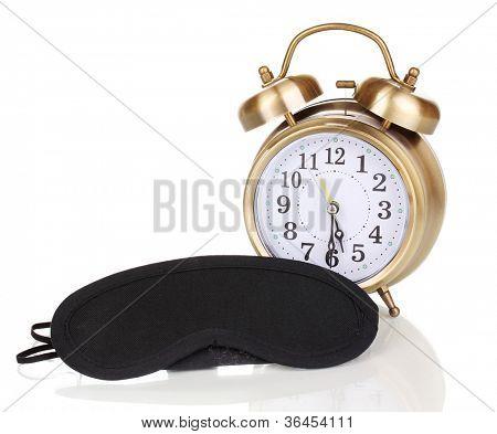 Sleeping mask and alarm clock isolated on white