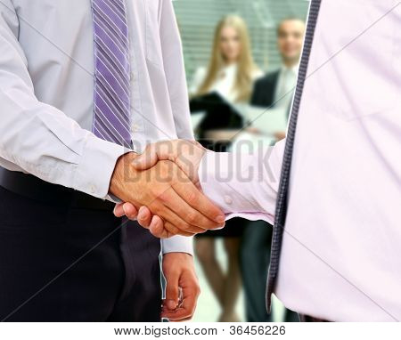 Handshake in front of business people