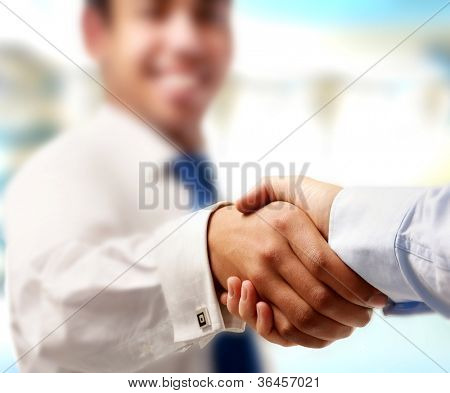 Closeup von einem Business-Handshake, isolated on white