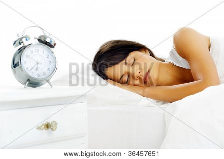 Portrait of a peaceful beautiful woman sleeping in bed resting and happy. isolated on white background