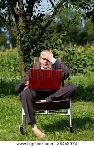 Tired Man Businessman overworking outdoors, as freelanser