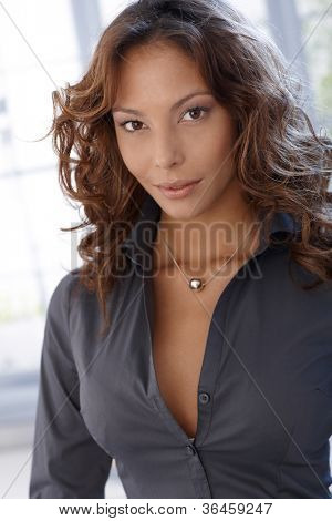 Portrait of attractive ethnic female, looking at camera.