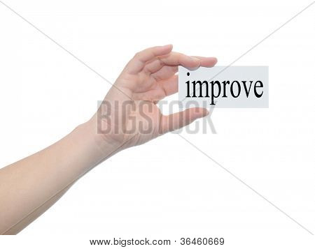 Concept or conceptual human or man hand isolated on white background holding a paper banner with a black text as a metaphor for business,management,marketing,vision,improve,goal,success or seo design