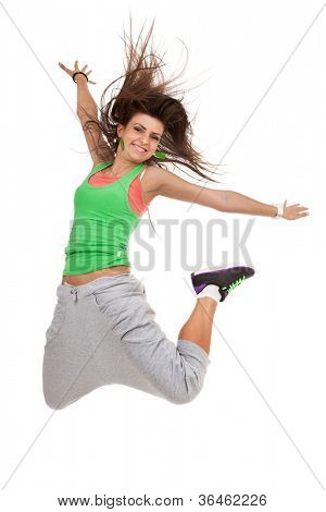 Happy young dancer jumping with arms extended, against isolated white background