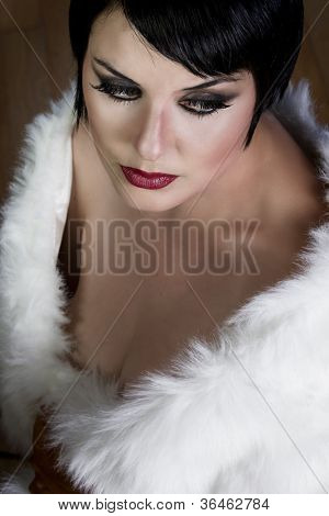 20s style beautiful brunette female wearing fur, exquisite old hollywood style, star